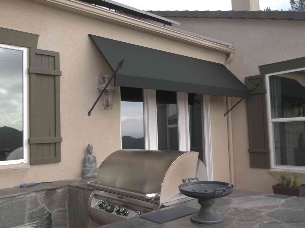 DECORATIVE SPEAR AWNINGS BY THE AWNING COMPANY 26